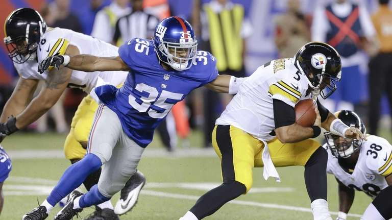 Giants free safety Quintin Demps reaches for Pittsburgh