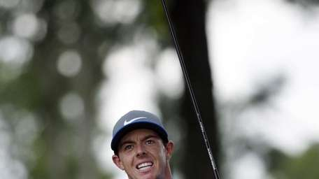 Rory McIlroy, of Northern Ireland, watches his tee