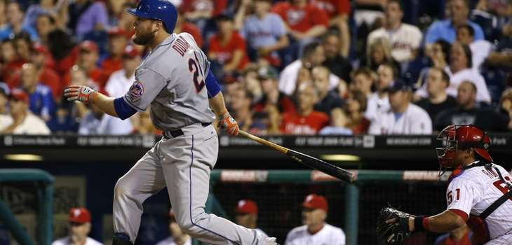 Mets' Lucas Duda, left, follows through after hitting
