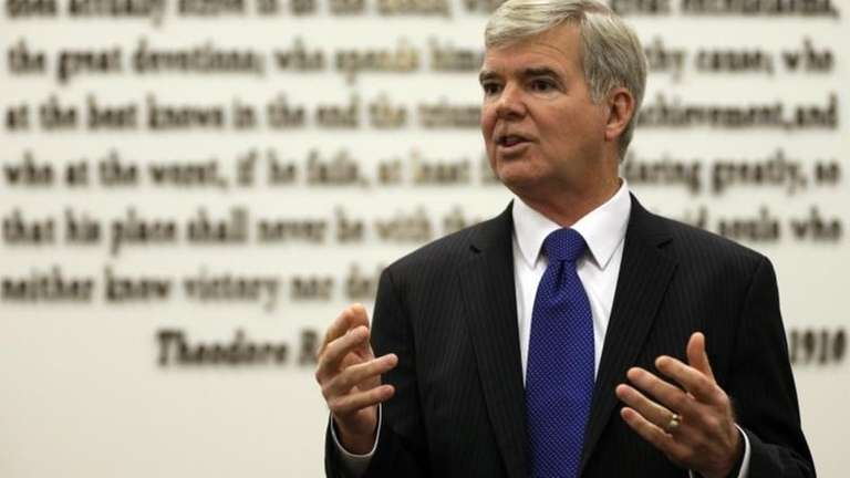 NCAA President Mark Emmert gestures while speaking at