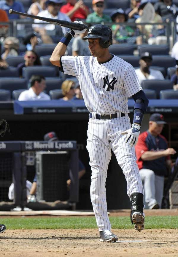 Derek Jeter reacts after striking out to end