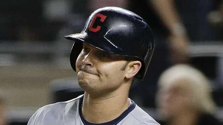 Cleveland Indians first baseman Nick Swisher reacts after