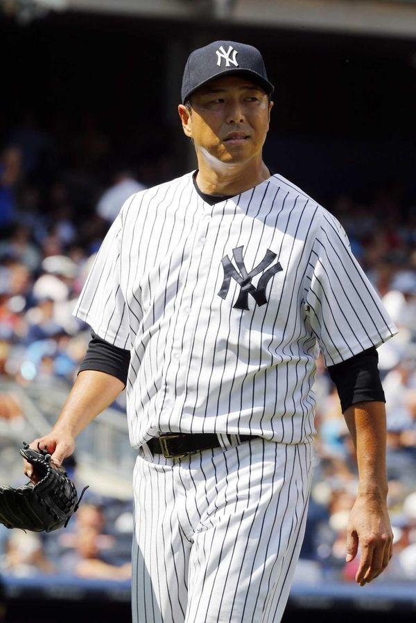 Hiroki Kuroda walks off the field as he