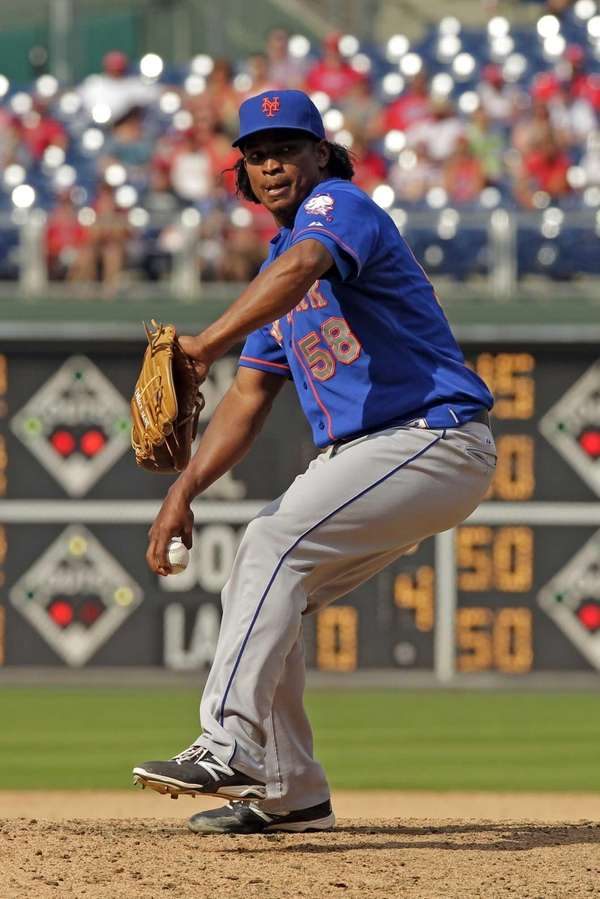 Closer Jenrry Mejia throws a pitch in the