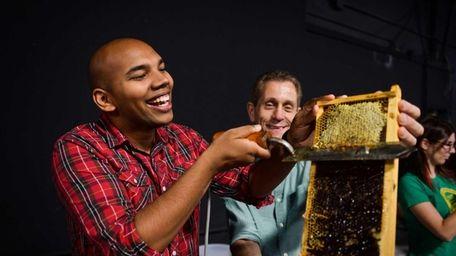 Shem Ishmael, of Hempstead, cuts honey comb while