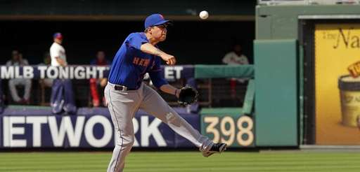 Wilmer Flores throws to first base after fielding