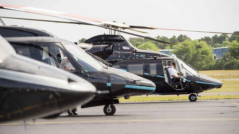 Helicopters sit on the tarmac at East Hampton