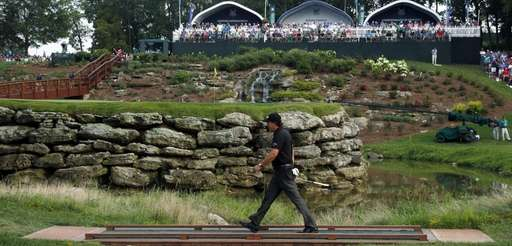 Phil Mickelson walks to 13th green during the