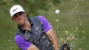 Rory McIlroy, of Northern Ireland, hits out of