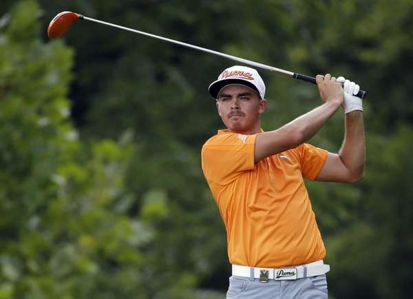 Rickie Fowler watches his tee shot on the