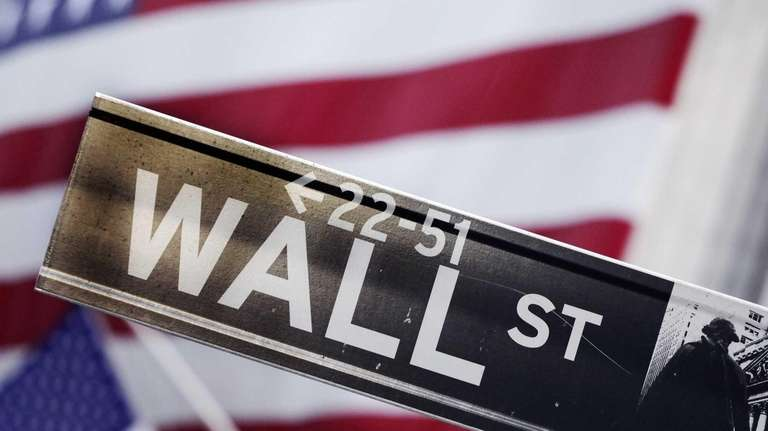 A Wall Street street sign near the New