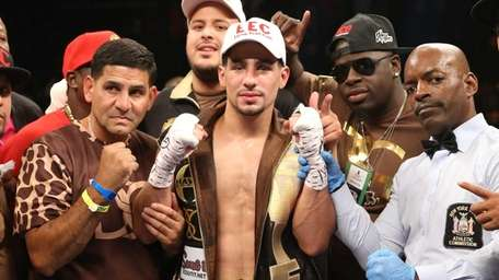 Danny Garcia (center) celebrates his knockout win over