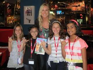 Surfer Bethany Hamilton with Kidsday reporters Mackenzie Setton,