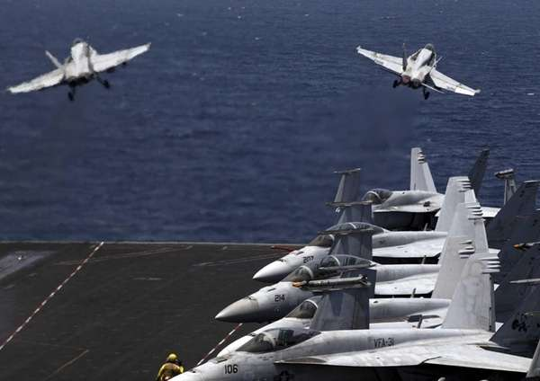 U.S. F/A-18 fighter jets take off for mission