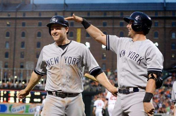 Chase Headley #12 of the Yankees celebrates with