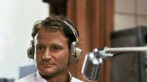 Robin Williams as disc jockey Adrian Cronauer in