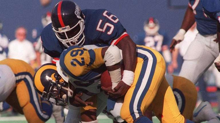 FILE--New York Giants linebacker Lawrence Taylor (56) tackles