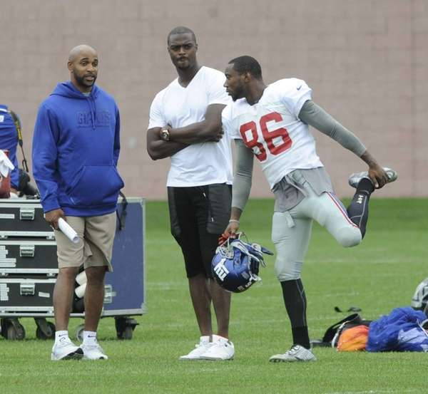 From left, the Giants' David Tyree, former receiver