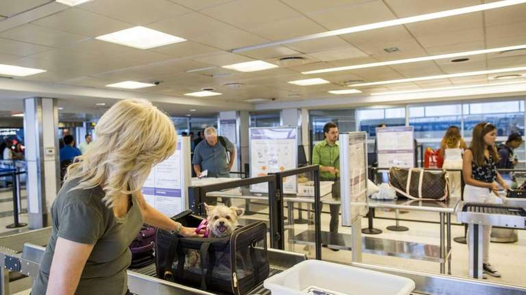 Mary Waldron walks through security with her 10-year-old