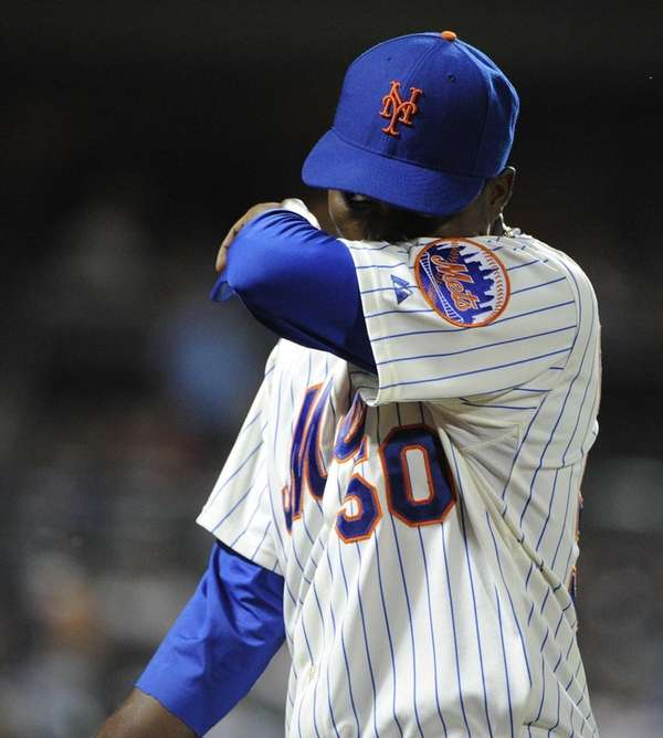 Mets starting pitcher Rafael Montero walks to the