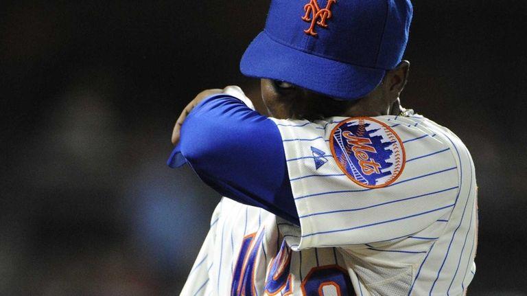 Mets starting pitcher Rafael Montero walks to the