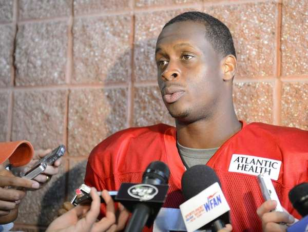 Jets quarterback Geno Smith talks to reporters during