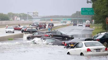 Cars stuck in water from the heavy rain