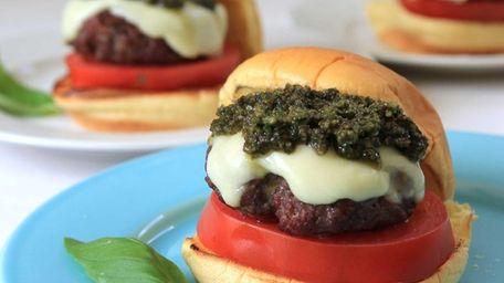 A Caprese burger with pesto and melted mozzarella.