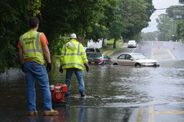 Brookhaven Highway Department workers pump water on Boyle
