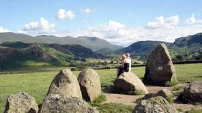 Sitting on a stone at the Castlerigg Stone