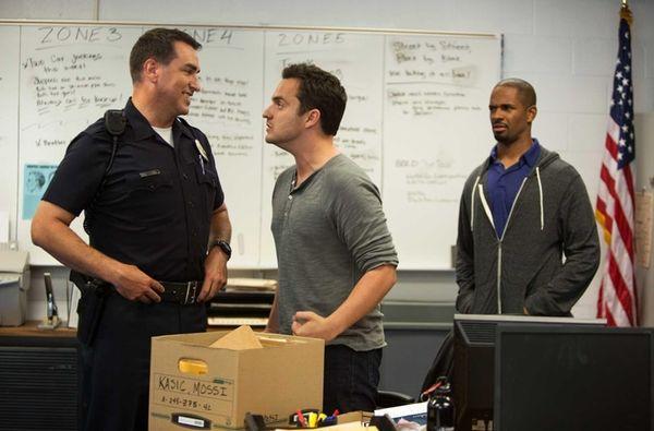 Jake Johnson, center, as Ryan, making an emphatic