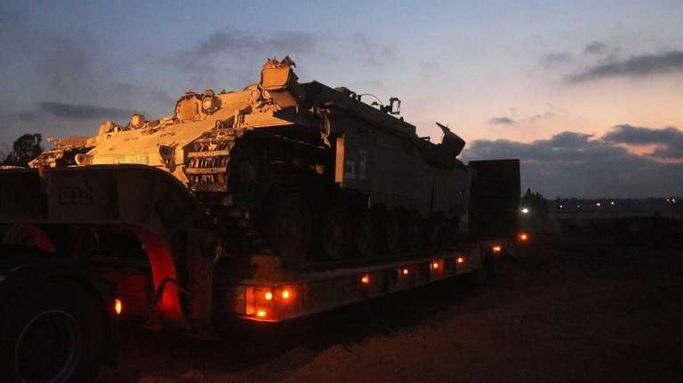 An armored personnel carrier sits on a trailer