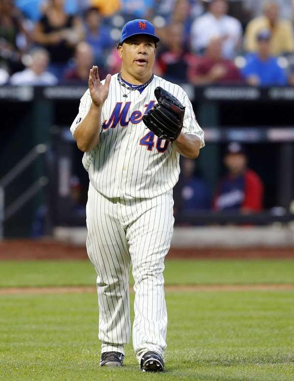 Bartolo Colon of the Mets walks back to