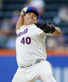 Bartolo Colon of the Mets delivers a pitch