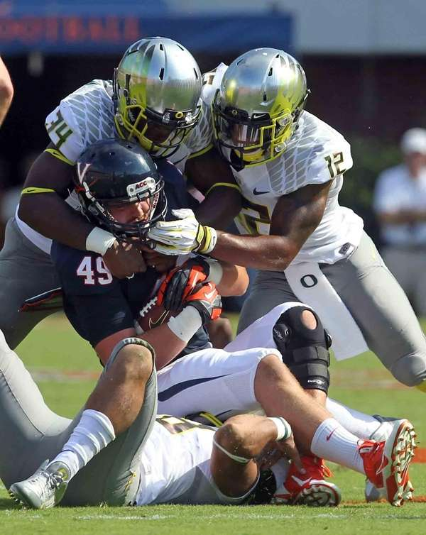 Virginia tight end Zachary Swanson is tackled