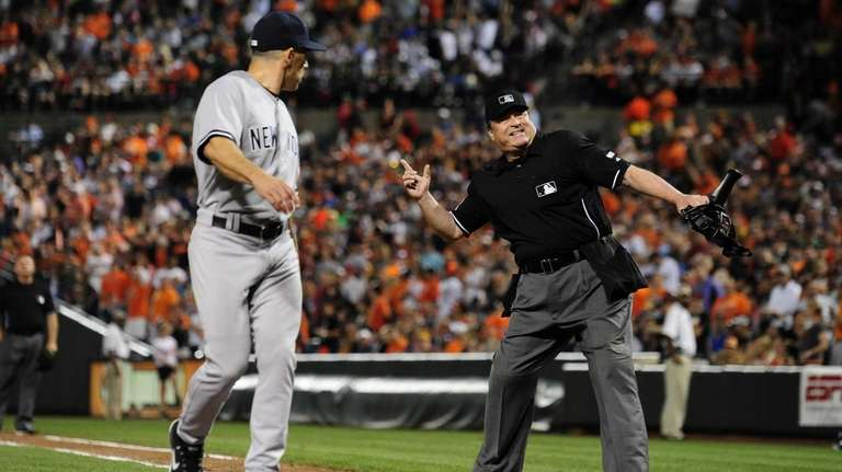 Home plate umpire Gerry Davis ejects manager Joe