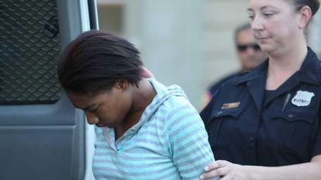 Ebony Robinson is escorted from Nassau County police
