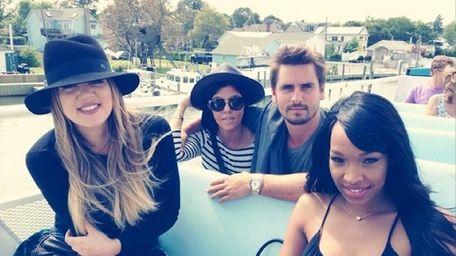 From left, Khloé Kardashian, Kourtney Kardashian, Scott Disick