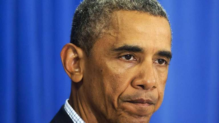 President Barack Obama pauses while speaking about the