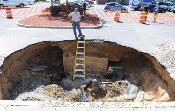 A large sinkhole remains at the Stop &