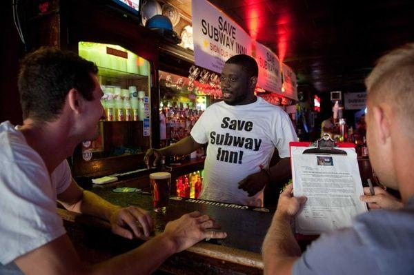 Will Sutton tends bar at the Subway Inn