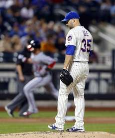 Mets pitcher Dillon Gee looks on after surrendering