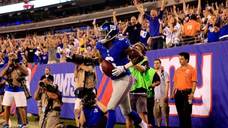 Wide receiver Corey Washington of the Giants celebrates