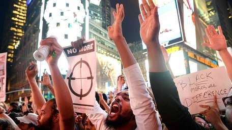 People chant during a march in Times Square