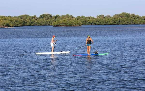 Moms and daughters can paddleboard together in a