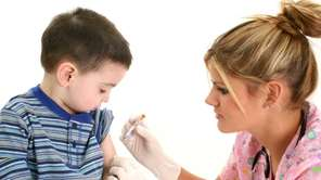 A child gets a vaccination.