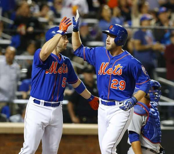 Eric Campbell of the Mets follows celebrates his