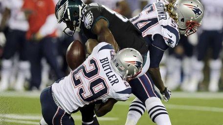 Philadelphia Eagles wide receiver Ifeanyi Momah, center, fumbles