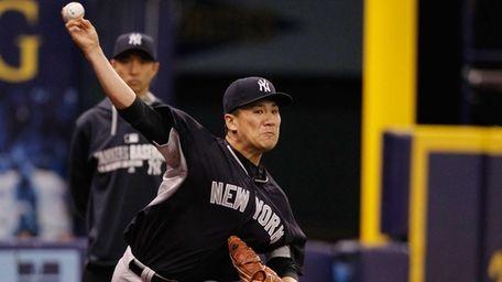 Masahiro Tanaka of the Yankees pitches in his