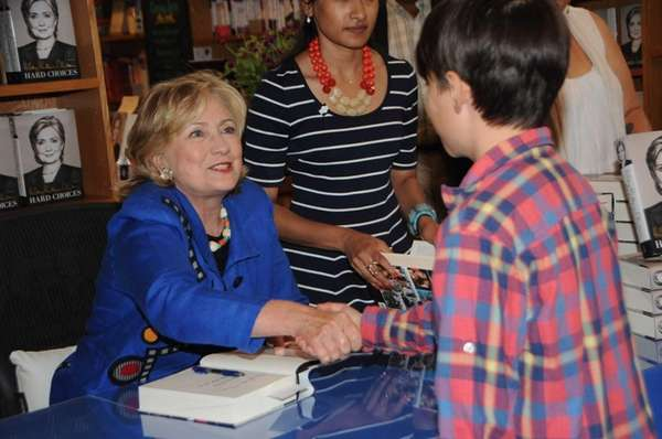 Hillary Clinton greets fans and signs books at